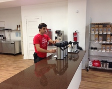 Owner, John Kepner, prepares a cup of coffee at the counter